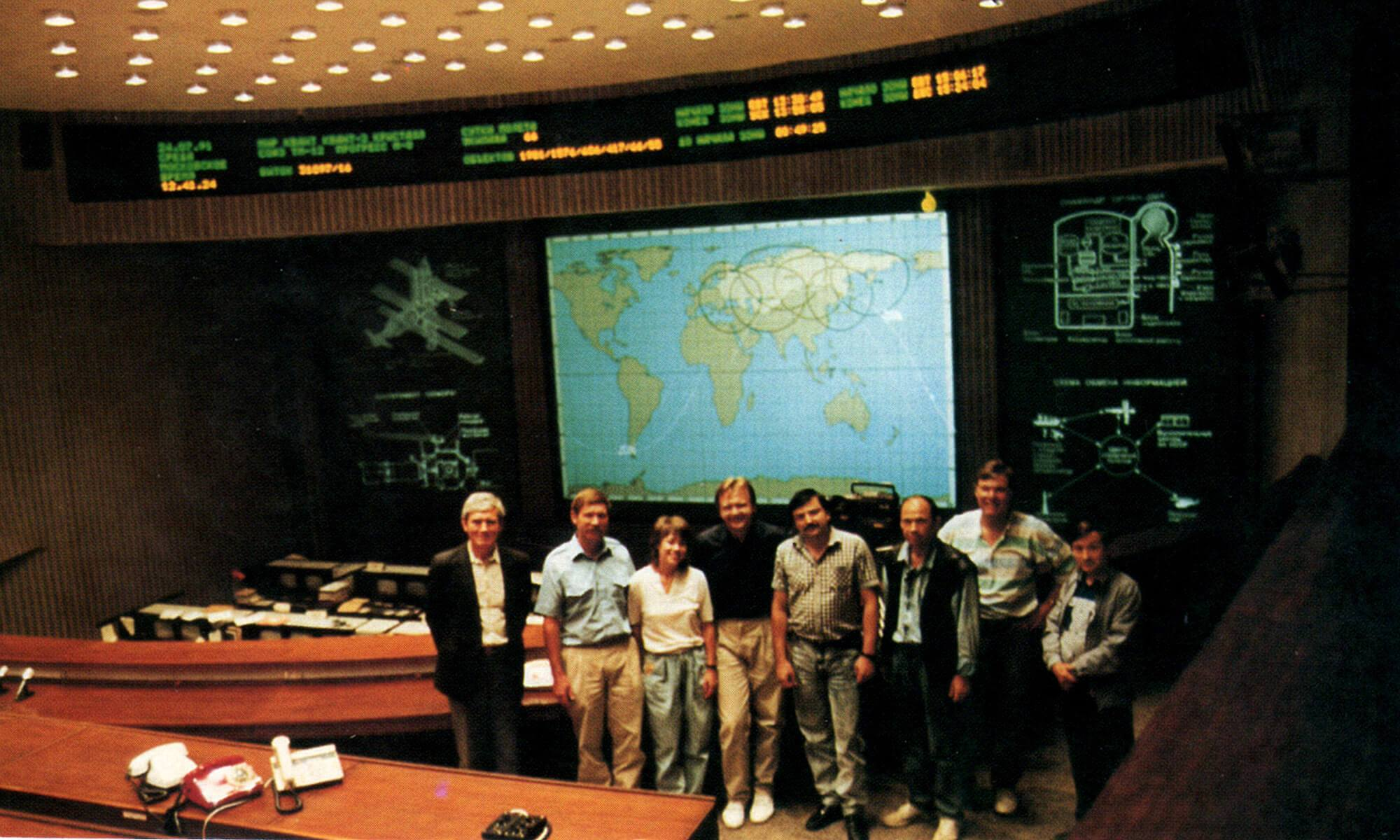 The flight crew and officials at the Soviet Mission Control Center in Moscow.