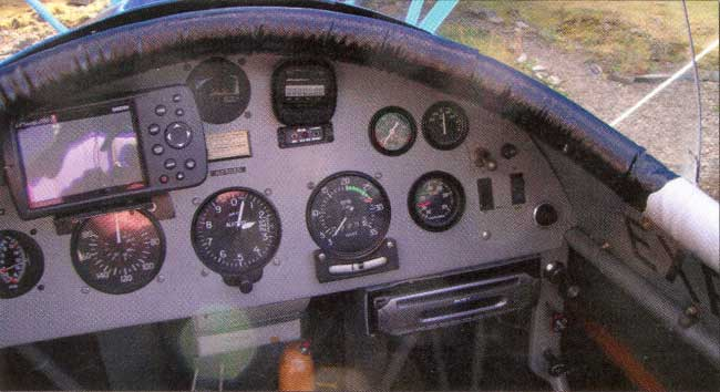 The panel has all of the accoutrements one would need for open-cockpit, cross-country flying.